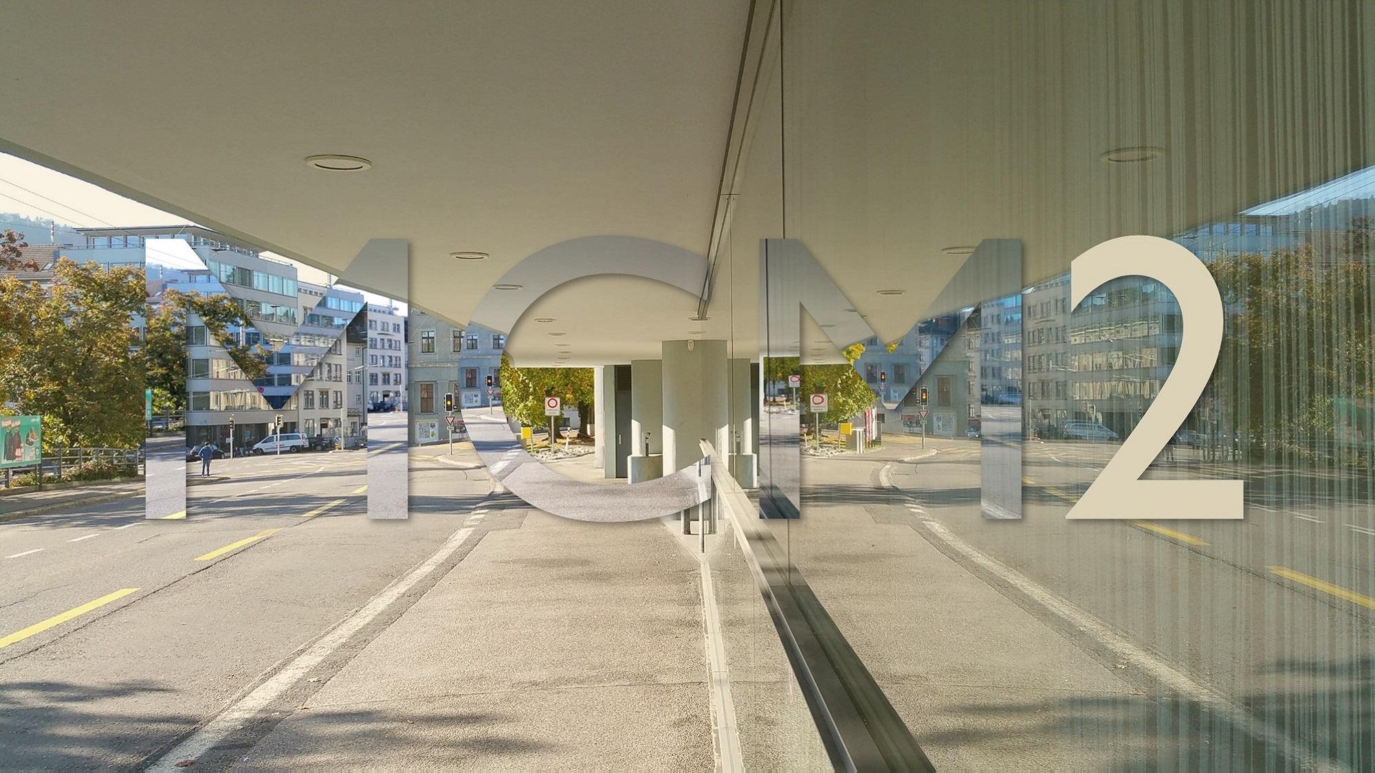 MCM2 Logo, street and glass window facade reflecting street
