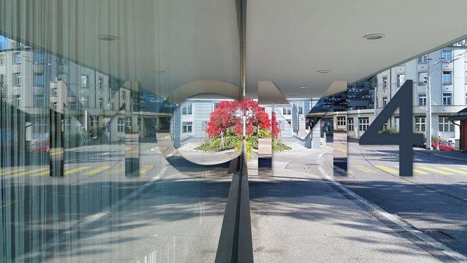 MCM4 Logo street and glas facade reflection