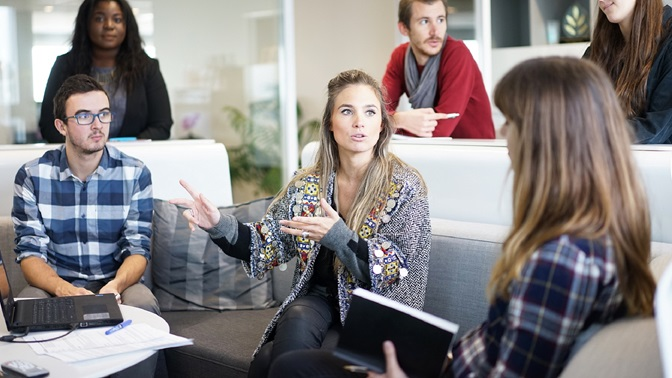 Consulting, team session, stock photo, six people three in focus discussing